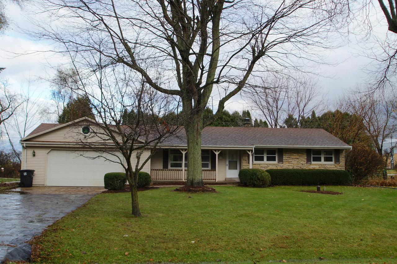 Well maintained Menomonee Falls ranch situated on over 1/2 acre lot. Beautiful HWF's throughout. Spacious living room open to dining room w/patio doors to large deck overlooking mature and private yard.  Unfinished full bsmnt w/tall ceilings is ready for your future rec room!. Attached 2.5 car garage.