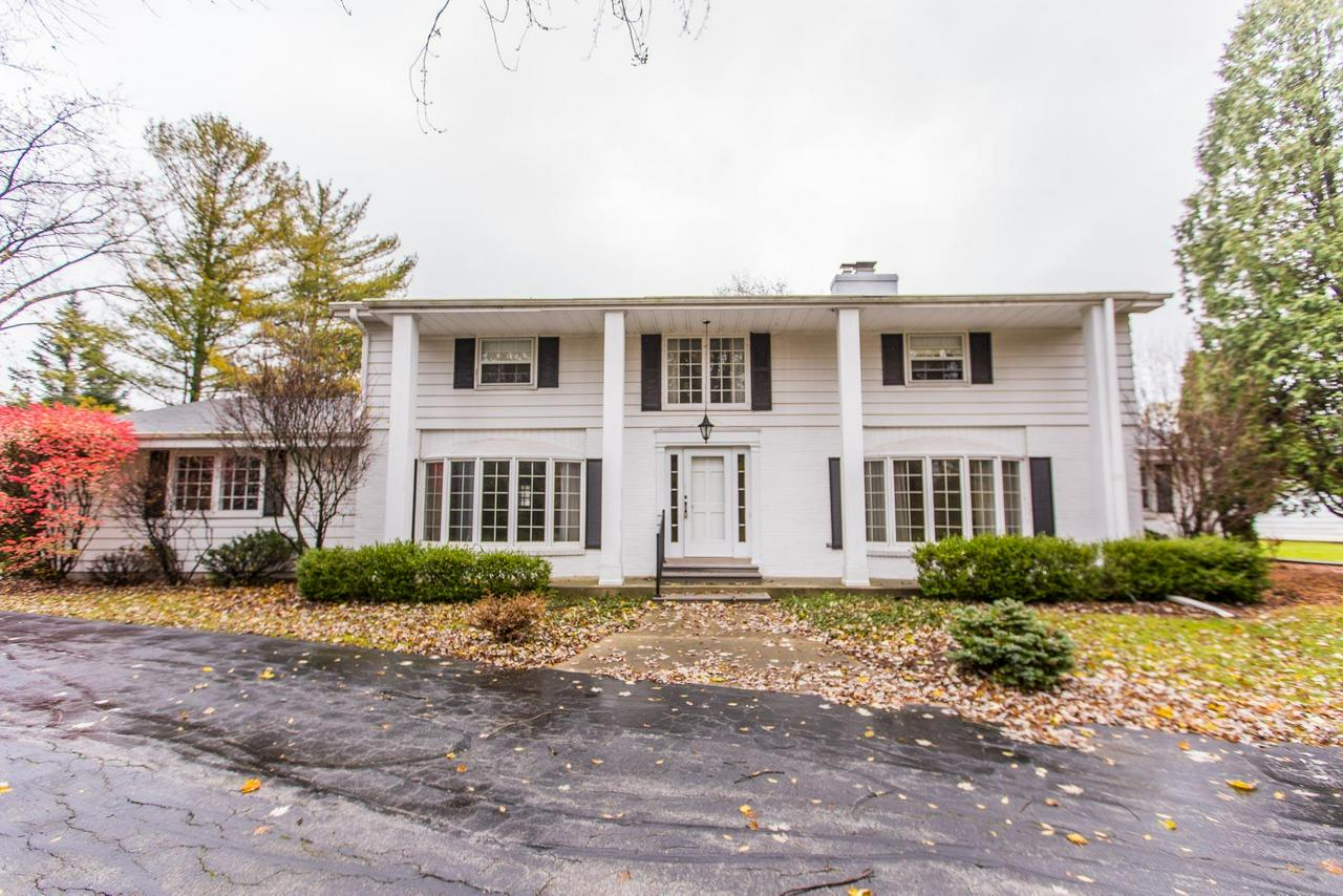 Classic center entrance Colonial, with circular driveway, nestled on an almost three-acre, private lot, with in-ground pool! First-floor bedroom and bath with four spacious bedrooms upstairs. Well maintained exterior, with mature landscaping, and lots of patio space around the pool for entertaining. Two large free-standing garages for extra storage. Make this your dream home!