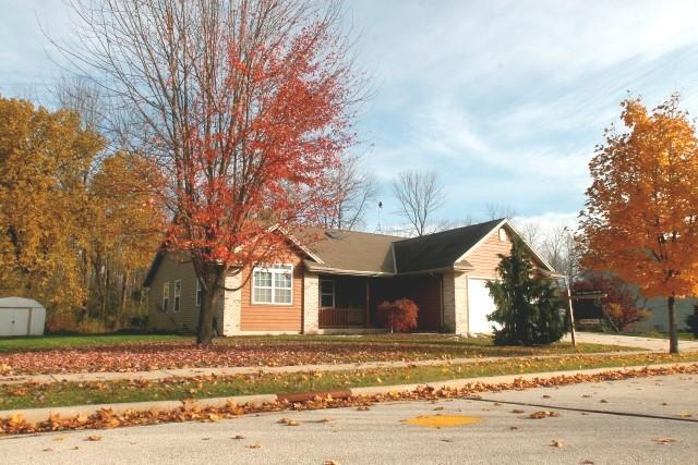 SELLERS ARE SAYING - Bring us an offer! We are motivated. Time to sell. SPACIOUS & UPDATED RANCH in the Village of Belgium. NEW FLOORING THROUGH OUT. Cute curb appeal & covered front porch. Check out this quality constructed 3 bedrm, 2.5 bath Ranch! Enjoy all the living area on the main level featuring an open concept living, dining and dinette areas with a pass thru from the kitchen. Cathedral ceilings; fireplace! Beautiful hardwood floors in kitchen & dinette areas along with oak raised panel cabinets, 6 panel doors, main floor laundry. Master BR suite has huge walk in closet & surround sound system. Professionally finished lower level w/huge family area along with a workout room and/or office & a half bath. Exterior boast of spacious green space to enjoy along with a covered rear patio.