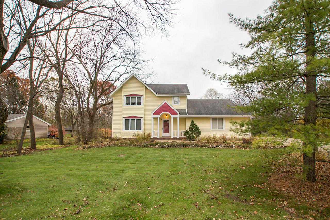 Welcome home to a well cared-for 2 story in Elmbrook school district offers modern, open floor plan with generous room sizes. Hardwood floors, newer windows, bay windows, eat-in kitchen opens to family room, plenty of cabinet storage, Quartz countertops are just some of the features of this home. A formal living room opens up to a large dining room. Master suite offers dual closets and a bath with a whirlpool tub. Basement features a large rec room and plenty of storage. An inspiring tree lined yard view can be enjoyed from a multi-season Gazebo that sits atop a multi-layered deck in the backyard. Multitude of updates including a new furnace and a spectacular location makes this home a must see.