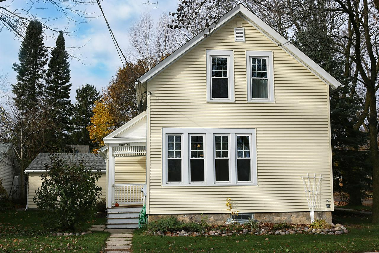 Adorable bright and sunny circa 1885 Cedarburg Farm House will melt your heart!  Located just steps from Historic Downtown Shops, Festivals, Summer Sounds and is right across the street from the popular Interurban Trail.  What a location! This home has been lovingly cared for and tastefully updated over the years.  The home features 2 generous Bedrooms, (15X10) and 2 updated Full Baths!  Main Floor full bath features walk-in tile shower with heated tile floors.  Roomy eat-in Country Kitchen with all Stainless appliances including Subzero Fridge.  You will love the unique ''Bonus Room'' off the garage which has heat and A/C and is fully insulated for year round use.  Bring your ideas!  Beautiful yard with mature trees, garden shed for storage and a white picket fence ties it all together.