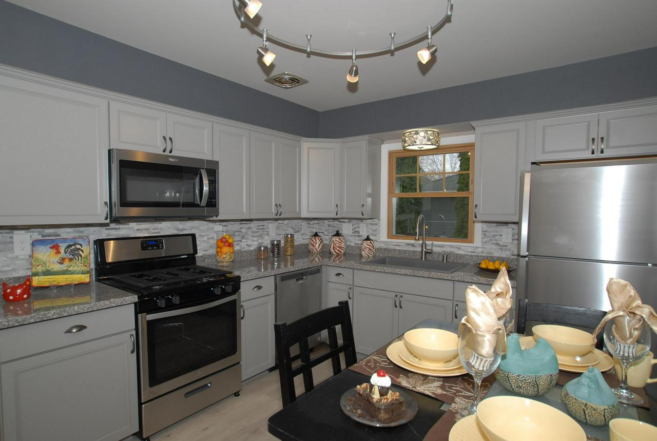 Absolutely Move-in Condition Contemporary Ranch in a Great Neighborhood! Featuring a Completely Remodeled Gourmet kitchen w/ New cabs, granite tops, custom splashes and Stainless steel Appls w/ Dishwasher. Awesome New Baths must be seen. Newer mechanicals,  windows, roof & electric. Brand New furnace & C/A. HWF's in Living area & New carpet in bedrooms. Secluded lot. Bring your fussiest buyers, they will NOT be disappointed.