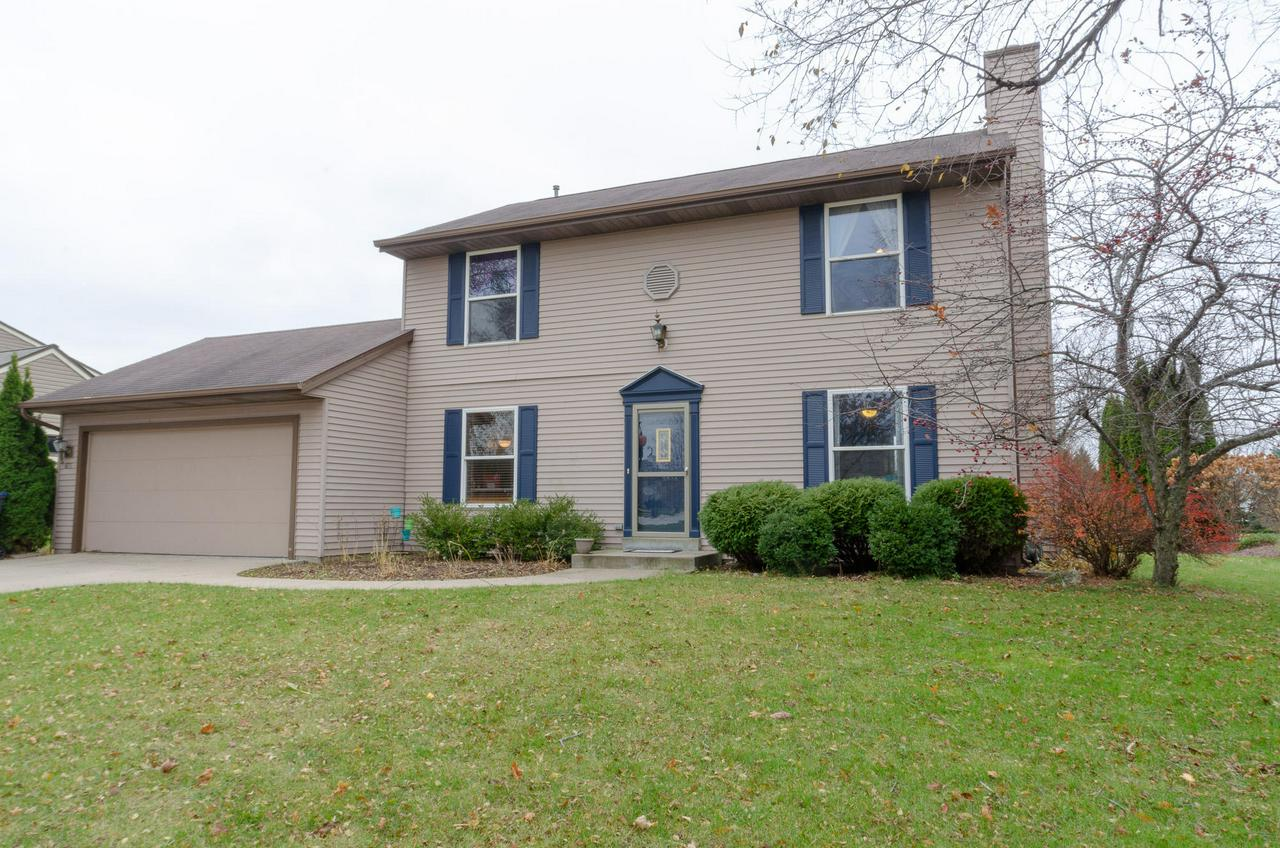 You will love this beautiful colonial offering 3 bedrooms plus Den/playroom.The elegant  kitchen offers newer stainless steel appliances, granite counter-tops and breakfast bar. Relax by the natural fireplace in the cozy living rm or entertain on the huge deck overlooking a wide open common space. Plenty of storage in the large laundry room/mud room makes it convenient when coming in from outdoors, right off the garage entrance.  Basement is partially finished for added livable space, complete with radon mitigation system.Situated in a friendly subdivision with sidewalks to parks and shops.  Be apart of the Award winning Pewaukee School.Come take a look around ,fall in love and make this house your home!