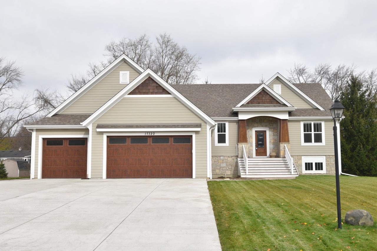 Welcome home to this stunning split 3 BR, 2.5 BA raised ranch home nestled on almost a half acre in the highly sought after Brookfield community with absolutely NO HOA! This Aspen Home completed in 2015 & sits directly across the street from a 21 acre nature preserve.  This open concept design features towering ten foot ceilings and the beautifully designed KIT surrounded by maple cabinets & stainless steel Whirlpool appliances & stunning granite counters along with a huge island covered in quartz. Elegant Paramount wood floors throughout the home along with rich alabaster carpet in the BRs. The MBA retreat features an oversized walk-in tile shower & a free standing bathtub. The full exposed LL is completely unfinished & awaits your dream ideas. Call & schedule your showing immediately.