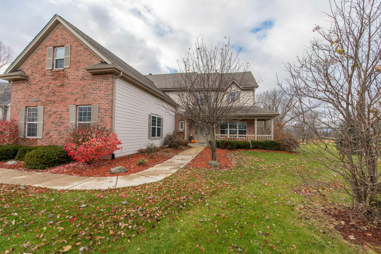 Stunning Colonial inside and out! Located on a cul-de-sac abutting Muskego Lakes Country Club, it's as quiet as you can get. When you step inside, the open concept kitchen and living area looks out at 16th green golf course views. Head up stairs to your master suite with ample room to relax! The lower level is wide open with an egress window and plumbing for a full bath so you can finish it any way you would like.