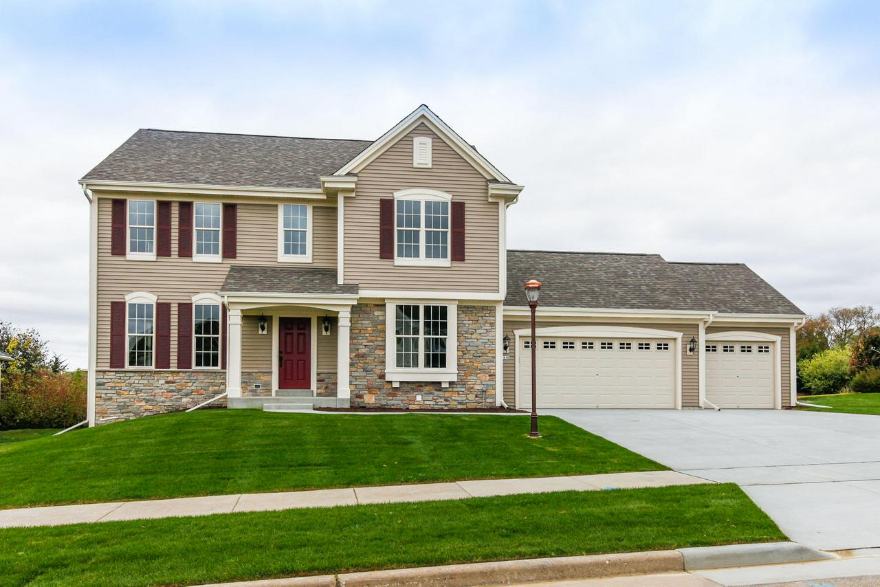 This unique living space includes everything that a family needs - a 3 car garage, a kitchen with plenty of cabinetry, walk-in pantry and  granite, prep island, a morning room for casual meals, a great room and a formal dining room for large family gatherings. The second floor rounds out this home with three secondary bedrooms, a hall bath, and a large owner's retreat complete with walk-in closet and deluxe bathroom featuring a dual vanity and five-foot shower.