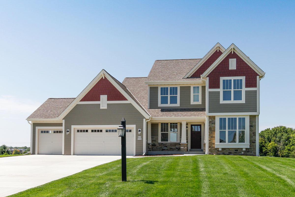 This two-story home has plenty of everyday living space including the gourmet kitchen, morning room and great room positioned in an open-concept format. The formal dining room and home office are located at the front of the home with an elegant switchback staircase that leads to a spacious second floor landing. The upper level is home to three secondary bedrooms and an owner's retreat that includes a large walk-in closet and deluxe bathroom with dual vanity and five-foot shower. Driveway and lawn included!