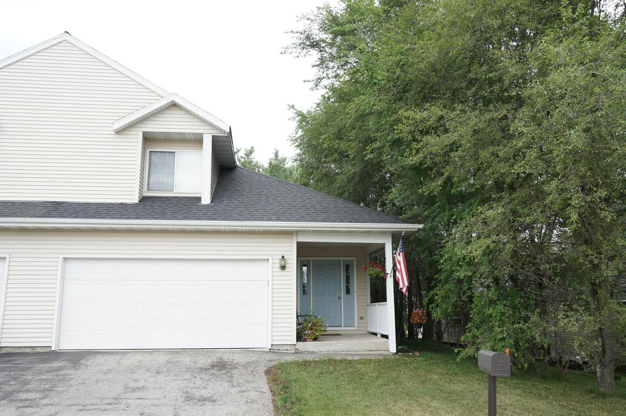 Here it is the one you have been looking for - affordable and easy living in this gorgeous 2br/2.5ba/2.5 car attached garage side by side zero lot line single family home. This is your ''condo alternative''! Enter the open concept great room w/vaulted ceiling and huge eat-in kitchen w loads of cabinets, plus patio doors to deck - great for relaxing or entertaining. Master suite offers WIC & full bath. Full basement - finished recreation room. This is a must see property. Schedule your showing today.