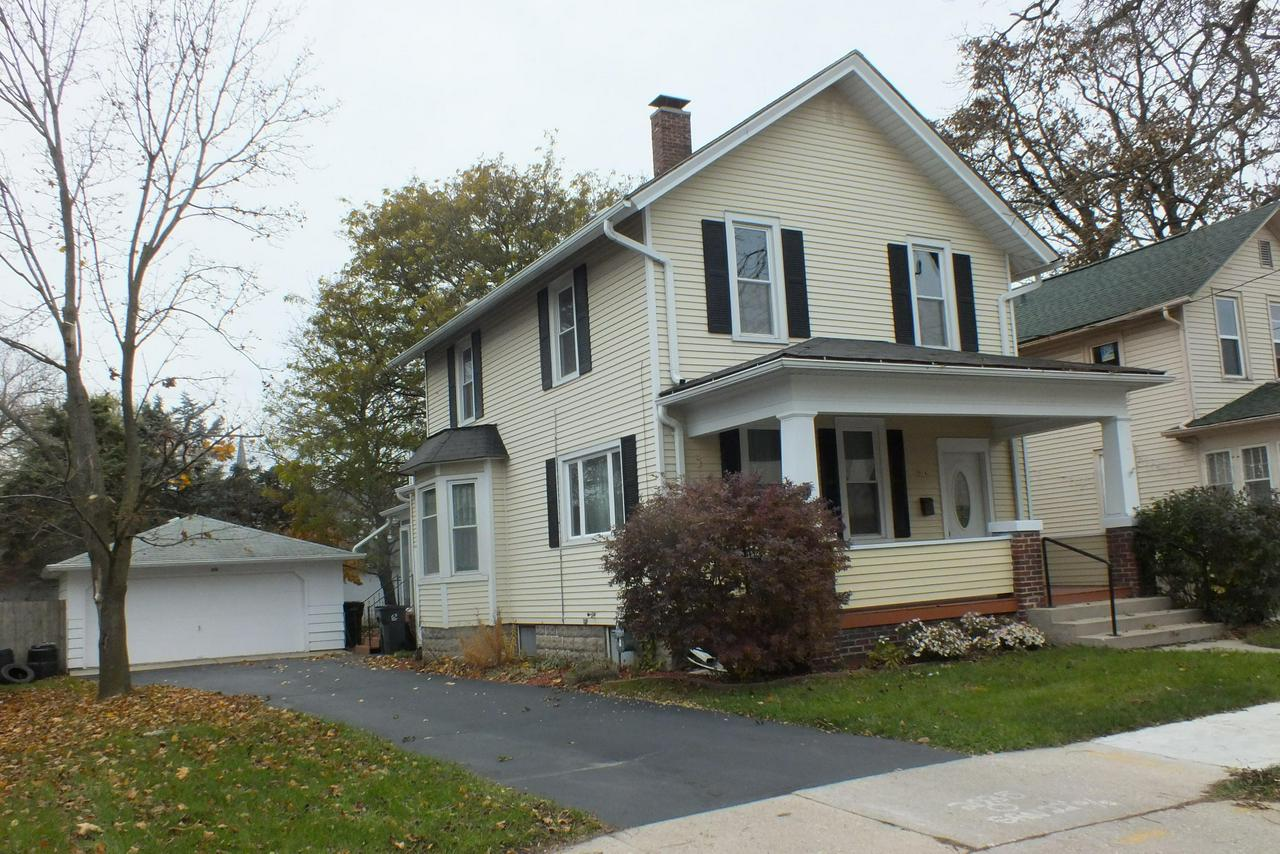 Long time owners have taken care and pride in their home and now welcome you to the neighborhood.  Your greeted by a large covered front porch and inside an open stair case to the second floor. Enjoy reading a book on the dens cute window seat. Big dining room and good size kitchen will make entertaining a delight.  Upstairs there is a hideaway room  that could be used for many purposes.  Newer high efficient heating system will keep your energy bills low. Large garage and fenced in rear yard is shaded for privacy. Lots of room in this home for the price come check it out today.