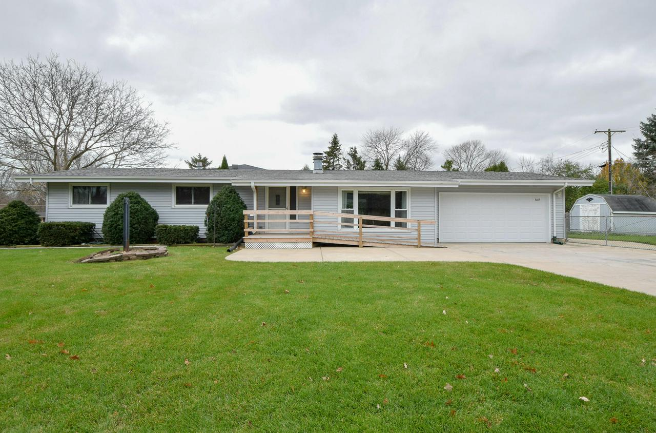 This home is ready for new owners to make their own.  Fenced yard on expansive corner lot.   No sidewalks to shovel in this quiet neighborhood.  Back yard has a nice deck that covers the back of home.  Living room with natural fireplace surrounded with gorgeous stone that covers the wall all the way to the basement.  2nd fireplace downstairs.  Abundant room downstairs in the recreation room which includes a wet bar and a 2nd full bath.  Windows have been replaced.  1/2 bathroom on first floor also includes a stackable  washer and dryer.