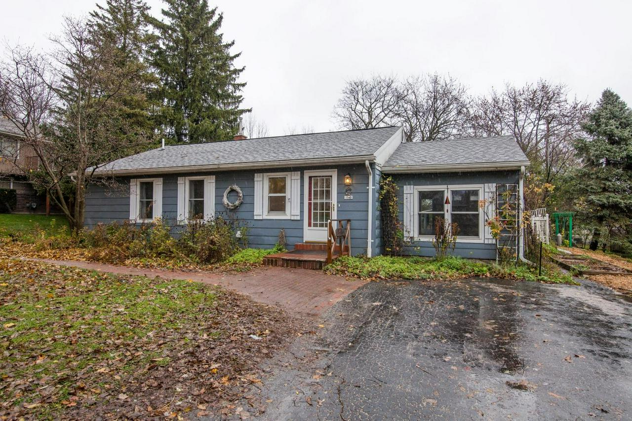 Welcome home to this cozy New Berlin cottage. 3 bedrooms & 2 full bathrooms with first floor laundry.  Freshly painted with laminate floors & gorgeous crown moulding. Gather together in the sunken living room. Master bedroom suite features private bathroom with shower stall & walk in closet with cedar lining. Updated eat-in kitchen has tons of storage with roll-outs & new countertop (being installed after Thanksgiving). LOTS OF RECENT UPDATES: roof (4-5 yrs), furnace (4-5yrs), well pump, windows (1992), dishwasher (3-4 yrs), oven/range (2-3 yrs). 3rd Bedroom could be used as an office/den, & features lots of built-ins.  Backyard is partially fenced & features lots of beautiful perennial gardens, trellis's, shed, brick paths & statues. Established Magnolia & Redbud trees.  Basement workshop