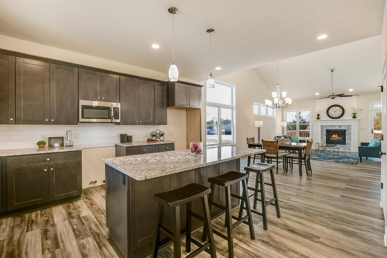 AWESOME!! You have Just Found the BEST & Most Affordable 3Br 2.5 Bath Condo Alternative, CONVENIENTLY Located Just 20 Minutes to just about anywhere. Its New Finished Construction & INFUSED with a TRENDY  Flare,  LOW MAINTENANCE Exterior & Boasts a Level Drive, Wide Open Floor Plan, First Floor MBR Suite w/walk in Tiled Shower & HUGE Easy Access DECK. Want a PRIVACY FENCE For those 2 & 4 Legged Family Members? Want Current Neutral Colors, Granite, Stainless, VAULTED Ceilings & Great Room with Fireplace Plus Rooom for Friends and Family & That Big Screen TV!! ENJOY Special Moments on the Front Porch or Walk on The BUG LINE or to The Shops & Restaurants of  Downtown Menomonee Falls. The Tall Unfinished LL Offers Endless Storage and an More ROOOM to Expand. YES...You Can Have It ALL!!