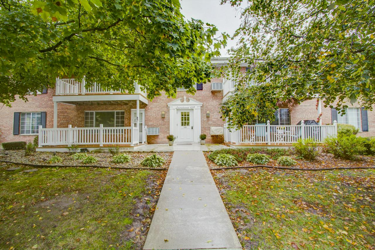 Beautiful and extra large condo that is ready to move in, Heat is included. Walk to shopping, entertainment, and park.  Beautiful finishes throughout. Open concept floor plan kitchen, dining, living room and extra sitting area that could also be used as a dinette.  New wood floors and blinds in living room, new stove, kitchen hardware and granite counters, newly painted interior. Enjoy the park like quiet setting.  Includes indoor and outdoor parking space,and extra parking