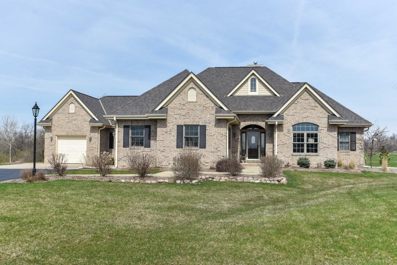 Spacious ranch, right between Chicago & Milwaukee is ready for new owners! Vaulted archways & ceilings! Huge KIT w/granite counters & cherry cabs. GR, DR & KIT have great views of private 1.2 AC lot. MBA: 2 sinks, jetted tub & heated tile floor. LL: exquisite, secure wine cellar, TV area, full BA, extra BR. Lovely landscaped yard w/irrigation system abuts conservancy. Stunning 2015 stone patio, seating wall & fire pit, the perfect place to enjoy amazing sunsets. New septic system installed October 2018! Hiking trails, fishing ponds & acres of green space. With easy access to I-94, this executive ranch is not to be missed!