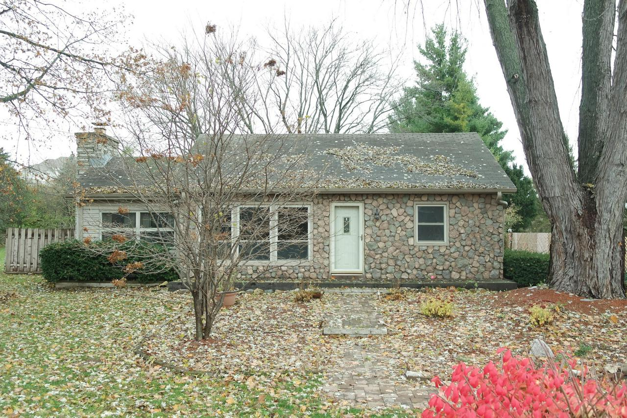 Stone ranch located on one acre. Lots of great potential for this house including the rec room downstairs. Master bedroom contains own private, full bath. Newly remodeled kitchen which has appliances included! Open living room to family room which gives great opportunity to host family & friends without feeling separated from each other. Backyard contains most of the acreage which includes the a patio with a stone fire pit. Call to get your showing scheduled today!