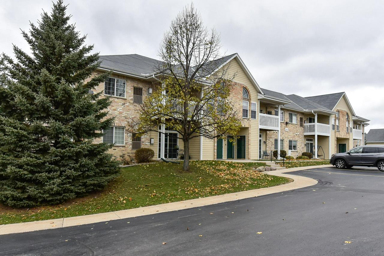 You can be in a new home for the holidays! This well cared for condo is perfect for the 1st-time buyer or someone looking to downsize. Watch sunsets from your living room while getting cozy in front of the gas fireplace with stone surround. The eat-in kitchen has a snack bar, as well as a nice-sized pantry, and both bedrooms are generous in size with walk-in closets. This condo also has in-unit laundry, private entry and two heated underground parking spaces. Updates include new carpet throughout and a new furnace. Enjoy all Port Washington has to offer every day!