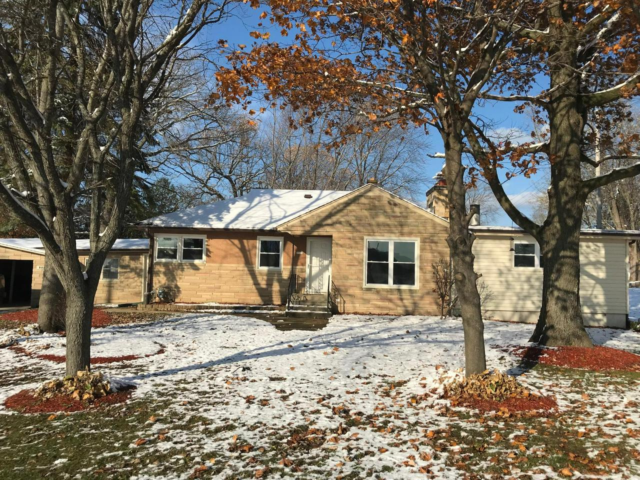 2 acres of pure perfection! This ranch style home is a MUST to see! Home is nestled on almost 2 acres!  This cozy home is COMPLETELY REMODELED!  With FOUR large bedrooms and TWO full bathrooms, you can't ask for more! The bright and brand new eat in kitchen offers plank style flooring with new cabinets and counter tops!   Cozy up in the spacious living room with a natural fireplace.  Perfect for the holidays!   Each and every bedroom is extremely spacious and has a TON of closest space!    Bring your rec room ideas to the large space offered downstairs.   Home has BRAND NEW IRON CURTAIN, WATER SOFTENER AND 50 GALLON WATER HEATER!   New Carpet in all rooms,  6 panel doors, and closets.  All NEW windows and DOORS! 2 car extra deep garage.   Outside is perfect for bonfires!  MOVE IN READY!