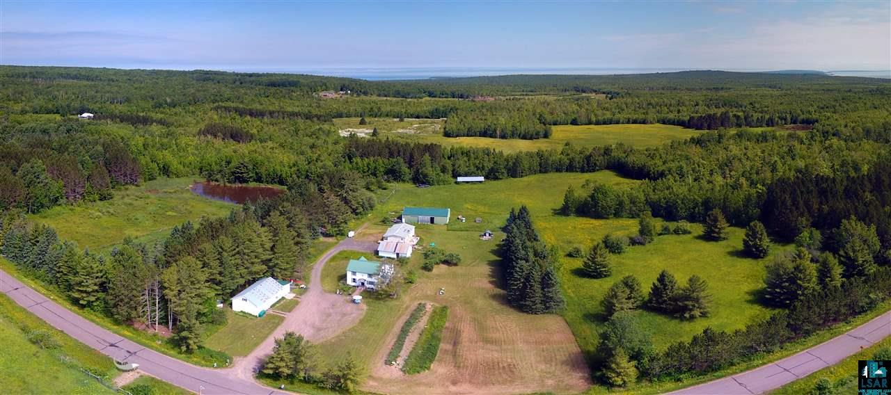 What more could you be looking for? Set on a peaceful 80 acres, this historic home has everything. 3 bed, 1 bath traditional country home. 3 car garage with workshop and fitness room, shed with humidity control room for storage, pole building, chicken coop, old timber mill and much more! Two large fenced garden areas with electric capabilities. Trails throughout the stunning hardwoods. Great spaces for a hobby farm with outbuildings, chicken coops, fenced areas, and a pond. Fruit galore - apples, pears, raspberries, blueberries and strawberries! Don't miss out on this charmer and schedule your showing today!