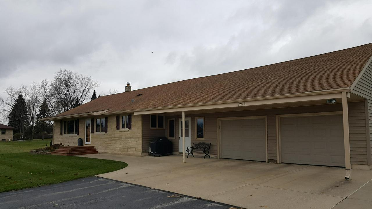 Meticulously  maintained  Ranch home with 3 bedrooms and 1.5 baths . Stone exterior with covered front patio as well as a  back deck and patio that overlooks a well manicured back yard with an extra  one car garage space / storage building with electric. The inside offers a large mudroom, updated Huge  kitchen with beautiful cabinetry and corian counter tops completely open to the great room with vaulted wood ceilings . The lower level is finished with a bar, family room with a gas fireplace and a finished room for a potential theater room. This home also offers a large added storage space in the completely open attic with its own private stairs. You Do Not want to miss out on this opportunity.