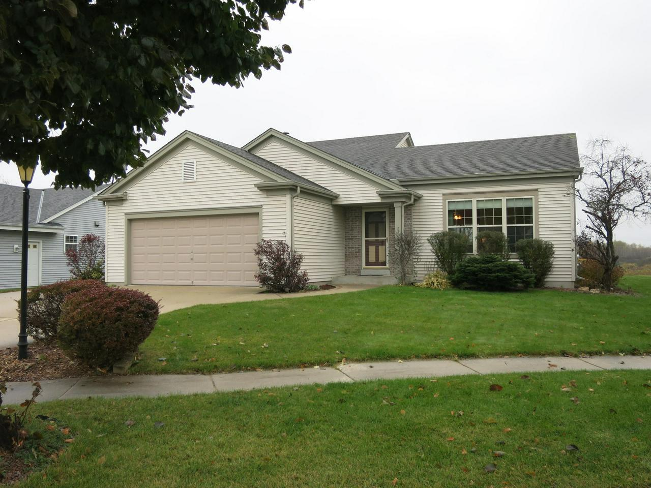 Situated on a quiet cul-de-sac, this spacious home has much to offer. There is new carpeting in the bright & cheery living room, a spacious kitchen with lots of cabinets and a dinette with a patio door leading to a large composite deck overlooking a conservancy to the back. The master  bedroom features a walk-in closet and private bath with a jetted tub.  The family room has full sized windows and a gas fireplace to enjoy the cold winter nights to come. The jetted tub in the spa-like room will provide wonderful relaxation. This great home is now ready for a new owner. Don't wait. Make an appointment today!