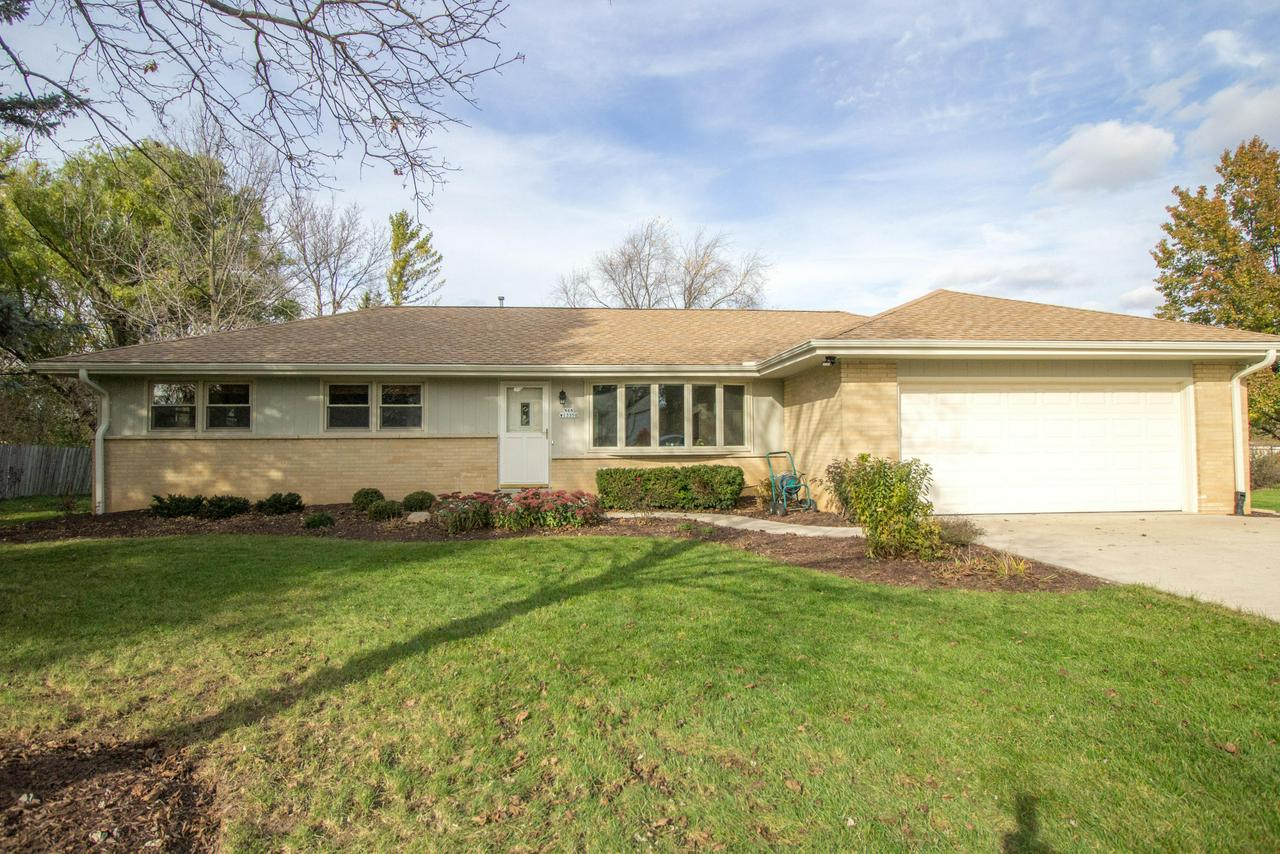 Pristine, well cared for ranch! Updated kitchen w/ brand new granite countertops & plenty of cabinet & counterspace. Adjoining dining room w/ patio doors to your own backyard oasis. Enjoy the almost half acre lot that is tree lined for privacy & also offers a gorgeous stamped concrete patio & beautiful gazebo, you'l love relaxing & entertaining here! Spacious living room w/ large bay window. Additional room that can either function as a family room or master suite w/ half bath, your choice! All bedrooms are a generous size & feature original hardwood flooring. Nicely updated neutral full bath. Newer windows throughout. Freshly painted exterior & interior. Rec room for even more space. Basement has been waterproofed by Everdry & offers a lifetime warranty. This one truly has it all!
