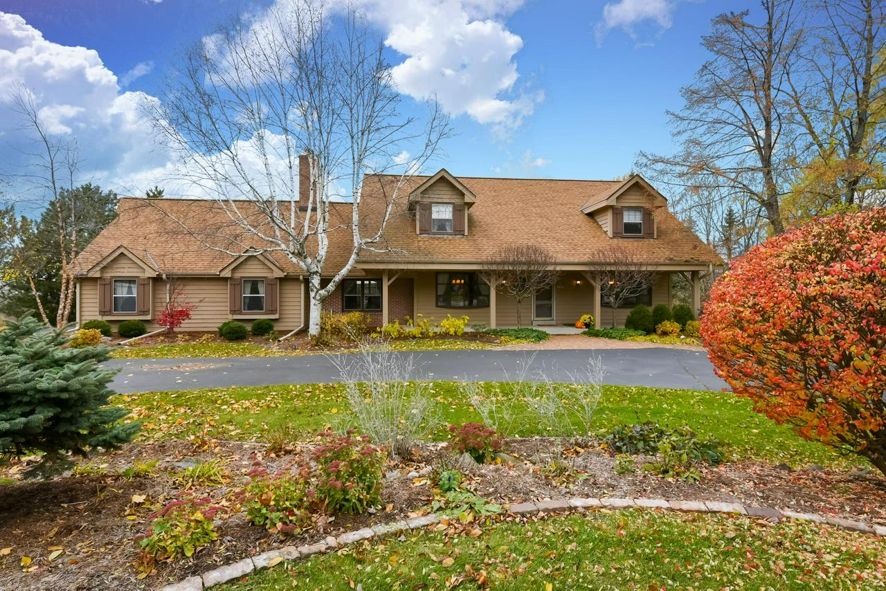 What an incredible opportunity to make this spacious cape cod your own! This beauty is nestled on 1.5 acres with a gorgeous, professionally landscaped yard, a convenient circular drive, and a private backyard complete with an 18x36 in-ground pool and hot tub to entertain your family and friends.  Enjoy amazing sunset views from the elevated deck!  Finished rec room in the basement with access to patio/pool area.  One year UHP Home Warranty included for peace of mind. Priced to sell! Bring your buyers today!