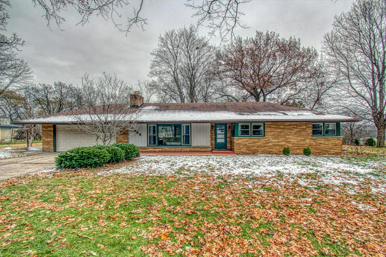 Move right into this spacious, updated 3 bedroom 1.5 bath brick ranch with a beautiful half-acre setting. Updated kitchen completely renovated in 2017 includes quartz counters, soft close doors/drawers, new appliances, new flooring, trim, paint, lighting and more! New boiler 2015; water softener 2016.  Hardwood floors on main except in bathrooms. Living room flooring is carpet.  Enjoy the fireplace in your living room in addition to the large picture windows with views of your private tree-lined yard. The Town of Brookfield has so much to offer with shops and restaurants galore nearby not to mention low taxes. Double closets in bedrooms and partial rec room in the lower level.  Westbrooke Subdivision is a highly desirable, peaceful neighborhood that you will truly enjoy!