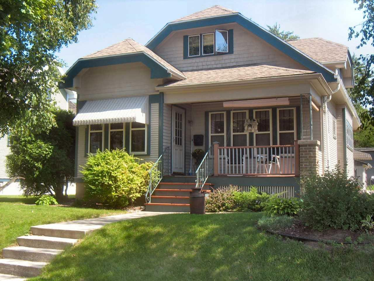 Welcome to all the warmth & character of this appealing craftsman style home. Quality details include beautiful maple hardwood floors & original woodwork throughout main floor, crown molding, lovely tray-ceilings, built-in buffet w/leaded glass & stain glass windows. Full baths on both levels w/option for first floor master or spacious suite upstairs. Additional features include inviting covered porch, expandable attic, central vac, patio w/privacy fence & natural gas grill hook-up, gutter guards, lovely landscaping w/perennials, 2 car garage w/extra storage space & alley access as well as 2+ car parking pad. Meticulously maintained & conveniently located near shopping, schools & park.