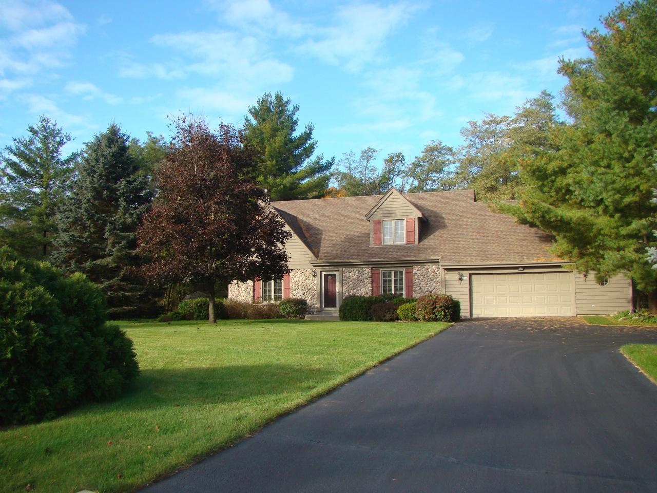 Beautiful nearly an acre setting on a cul de sac. Lovingly maintained, original Parade of Homes model showcases upgrades from that era. 5'x5' walk-in pantry, crown molding and first floor laundry. Kitchen offers quality raised panel cabinets, newer flooring; leads to expansive deck with pergola. The private back yard features a water fountain creating the perfect entertaining or relaxation spot. Inside, the room sizes will surprise you - Master suite has a bump out for seating with access to private balcony, huge walk-in closet and heated bonus room - possible for exercise, office or storage. Attic storage as well, with walk up access from garage! Newer roof and some windows have been replaced. Low town taxes w/ the convenience of West Bend and Hwy 45 only 3 miles away!