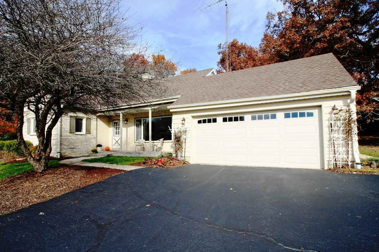 Are you looking for a personal retreat? This home offers peace and tranquility, only one block from Schoenstatt Retreat Center in the Kettle Moraine School Dist. This 4+ bedroom, one-owner home has been lovingly maintained and sits on a .93 acre lot with public access to Lake Etters, located across the street. Private, spacious backyard with large patio is a perfect place for outdoor entertaining. The exterior includes heated gutter guards downspouts. The natural fireplace in the updated living room adds to the warmth of the home. The lower level Rec room is another great entertaining space that includes new carpet, wet bar & bathroom. Kitchen updates-range, dishwasher were done in 2016. Come see if this lake access home is right for your family.