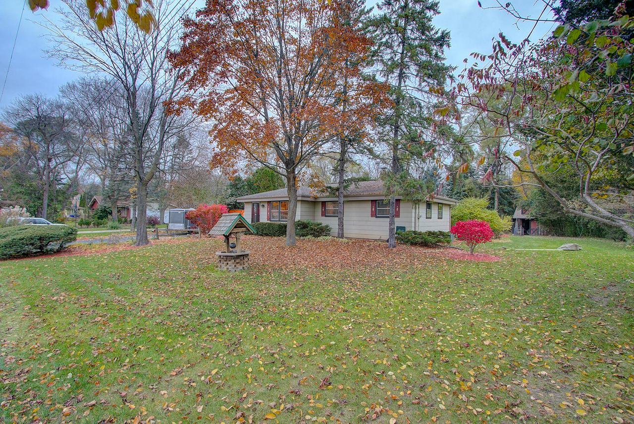 Wow! Don't miss this rustic gem in an outstanding secluded Muskego location.  Ranch style home is being sold by original owner and sits on a large .56 acre lot on a no-through street across from Jensen/Lee Hubka Park. You're just steps from Little Muskego Lake and minutes from I-43, so convenient!  Bright and open kitchen/dining room connects to warn and inviting 3-season room (built 2009) featuring GFP.  Master bedroom with attached 1/2 bath has sliding doors to deck and park like backyard. Partially finished basement has full bath, bar, and rec room perfect for entertainment. Oversized 2.5 car garage has overhead door in the rear for easy in and out of all your favorite toys. Large shed too. Per seller roof and gutters updated 2008, new well pump 2017. 1 yr HMS home warranty included too