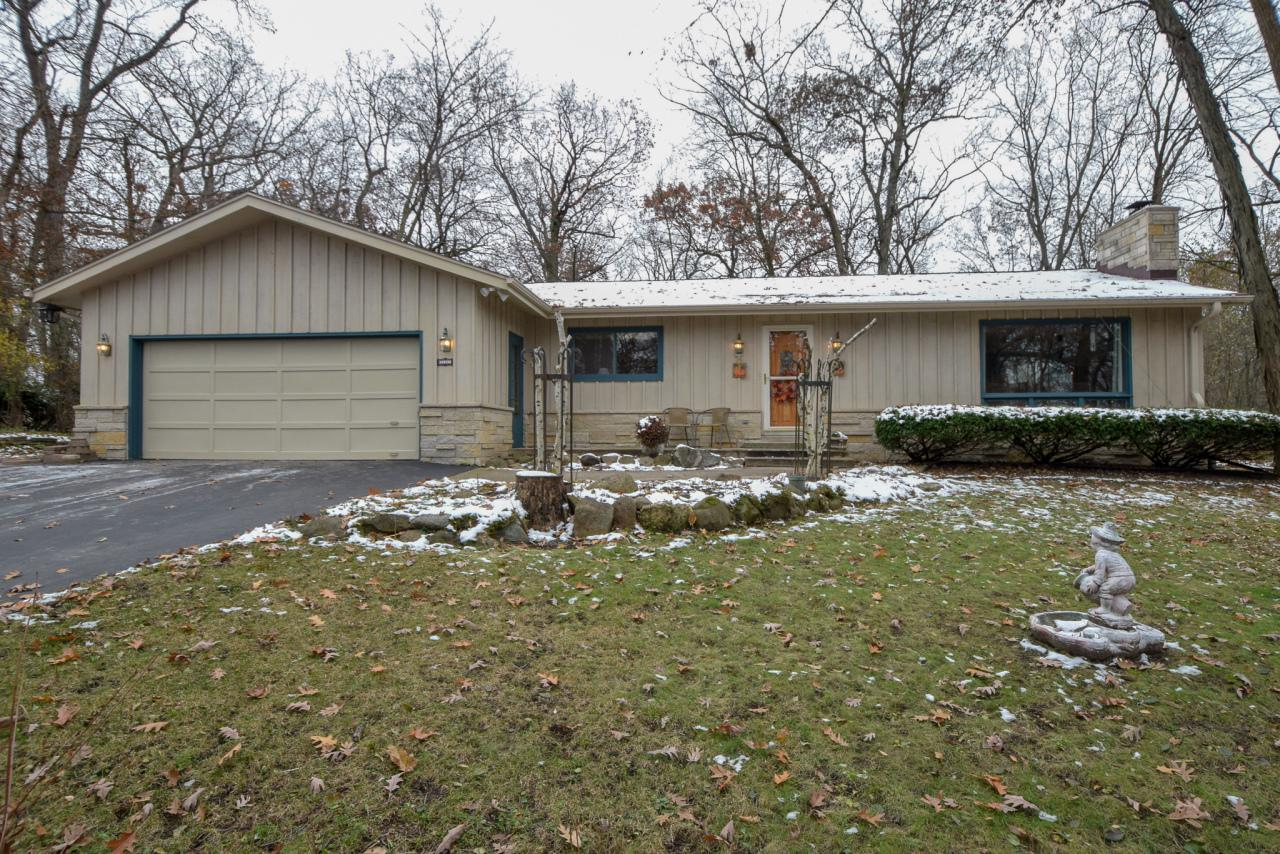 Nature Lovers Dream... 3 BR Ranch nestled on secluded wooded lot adjoining Minooka Park.  SPECTACULAR views abound & Quiet Serenity are just a pinch of what this FABULOUS home has to offer.  Lannon stone natural fireplace, Sky-lit kitchen, Open Concept main living space, Slate tile front entry way, Huge living room picture window for your viewing pleasure, Hardwood floors and Oak kitchen cabinets.  Nautical themed basement and 1st floor laundry hook ups.  This is a must see home on a truly unique location!!