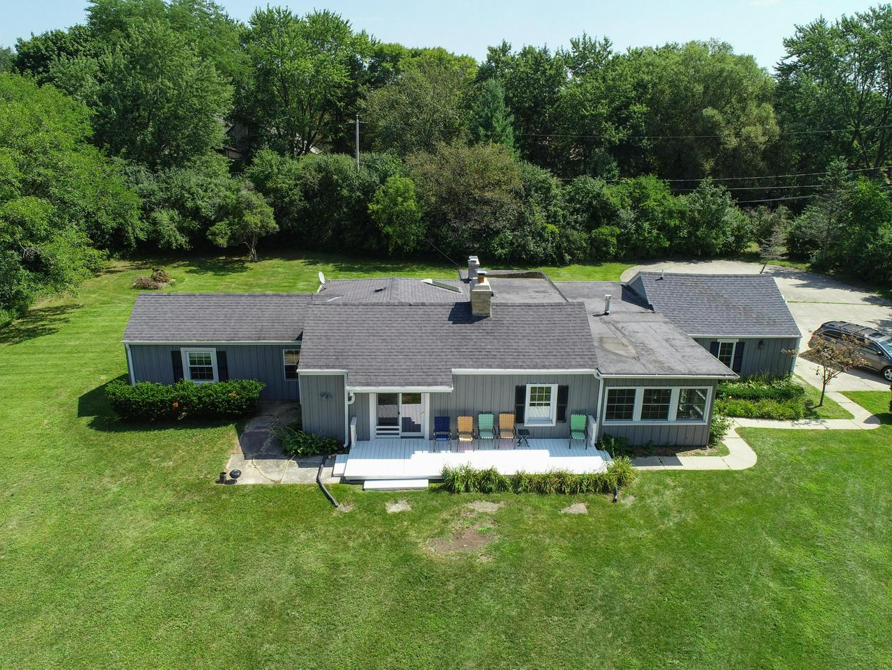 Fabulous opportunity to own a 3 bedroom 2 bath ranch on almost a 2 acre lot. Cozy up around the natural fireplace in the living room or enjoy family gatherings around the gas fireplace in the family room. Nice bright open kitchen giving off that farm house feeling. Beautiful pine flooring in the living room and kitchen. Situated over looking the Ozaukee Country Club with a Western sunset, relish evenings on the front porch. You will enjoy all that this stairless ranch has to offer. Seller has done many updates to this home. Or if your looking to build your dream home this 2 acre lot is perfect !