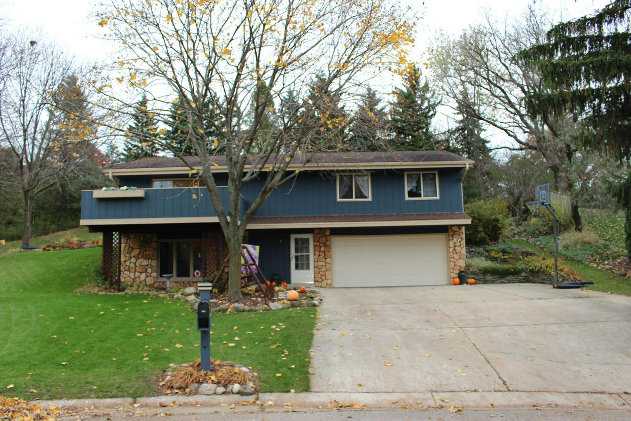 Beautiful raised-ranch home set on a quiet cul-de-sac lot has the style & space you are looking for. Desirable open concept living center features great room w/patio doors accessing the front deck & a kitchen/dining room combination w/Breakfast bar & stainless appliance package. Finished LL family room adjoins the rich rec room bar area w/deep wood finishes & built-ins. Spacious bedroom sizes, updated bathrooms & an extra deep garage add even more value. Great outdoor living options include the large elevated deck w/bench offering sunset views. Private back yard and patio with mature trees.