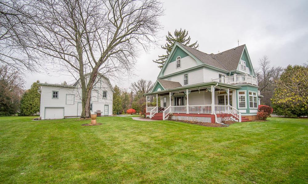 Charming & immaculate Victorian-style 3BR 3.5BA home nestled on over an acre of land that features a 3-story barn perfect for hobby or work. Gorgeous detailed woodwork throughout the home and windows galore that bring in tons of natural light. Grand entrance with beautiful natural fireplace. Huge open eat-in kitchen w/granite counter, stainless appliances, tile back splash, breakfast bar complete with ample storage and work space. Formal dining room is features large windows & built-ins. Living room & family room are plenty spacious for gatherings. Featured on the 3rd level of this home is a HUGE bedroom w/private bath, soaring ceilings w/gorgeous decorative trusses & windows galore! Enjoy the  covered porch great for entertaining. Additional outbuildings include:storage shed/outbuilding.