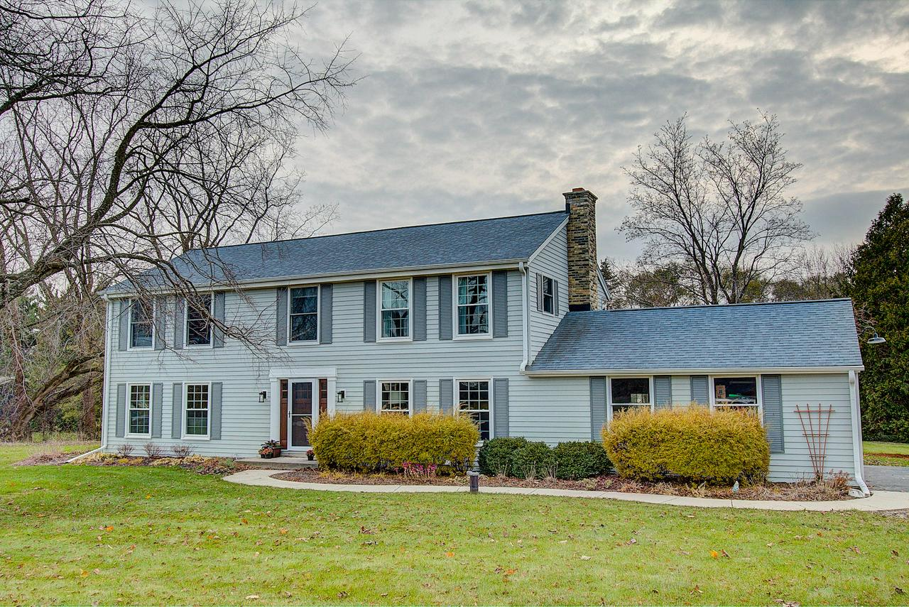 This completely remodeled home is a show stopper! The moment you walk in the door you will be pleased with the open floor plan, stylish finishes and excellent craftsmanship. The great room area combines the kitchen, dining and living areas with finishes like hardwood floors, granite, recessed lighting and lots of windows! The cozy family room offers views of the backyard and a natural brick fireplace.  Upstairs, 4 spacious bedrooms are tastefully done, with the master suite boasting 2 closets (1 WIC) and an updated attached master bath.  There is an open area being used as an office but the possibilities are endless. The finished rec room in the lower level offers even more living and entertaining space plus an exercise room. This home really has it all. Call today to see for yourself!