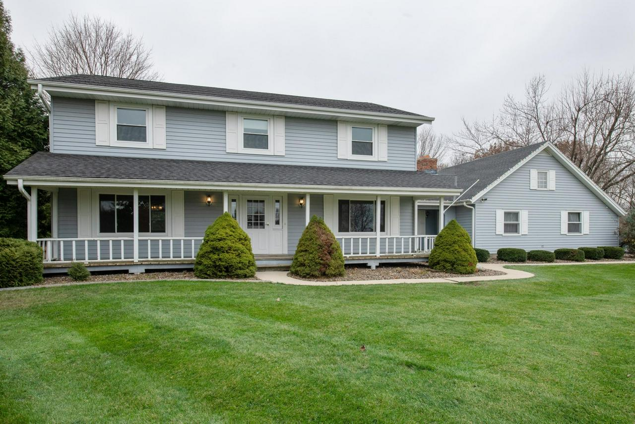 SPACIOUS is the best word to describe this two-story offering 2,790 square feet.  The home features 4 bedrooms, 2.5 bathrooms and is located on a 1.69 acre lot on a cul de sac. The main floor offers a sunken family room with brick natural fireplace, living room, formal dining room, kitchen/dinette with tile floor, 4th bedroom (would make a great office or toy room), half bathroom and main floor laundry. Upstairs you'll find the huge master bedroom (18x13) w/ full bath and patio doors to the upper deck AND an attached sitting room, along with 2 other very generous bedrooms and the main bath.  ALL NEW CARPET THROUGHOUT along with new flooring in the laundry, master bath and half bath.  All but two windows and one of the patio doors were replaced in 2017.  Call today!
