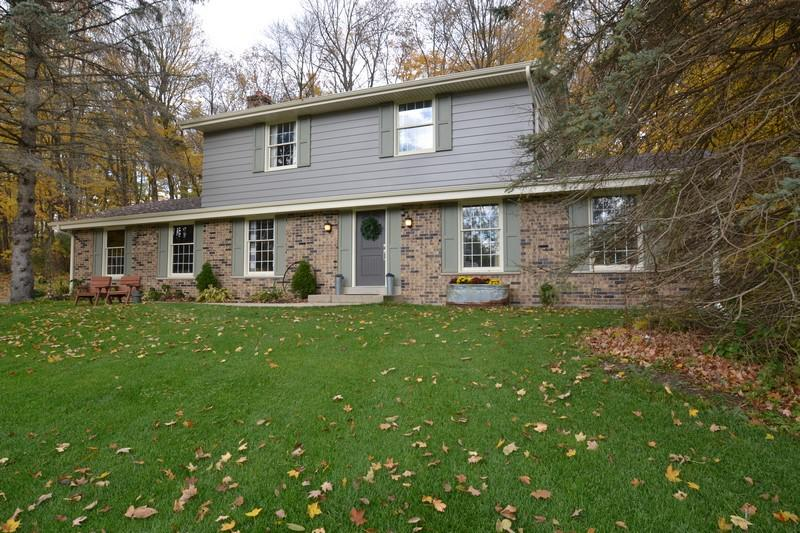 Lovely 4 bedroom, 1.5 bath colonial on 1 acre secluded wooded lot in very quiet neighborhood.  Beautifully landscaped yard with private backyard and new patio deck with awesome view of yard and trees. Many updates include newer roof (2016), furnace (2015), water heater (2015) and brand new central air. Full cosmetic updates include new lighting throughout! Relax in the family room with natural fireplace. 2.5 car garage. Make this home yours today!