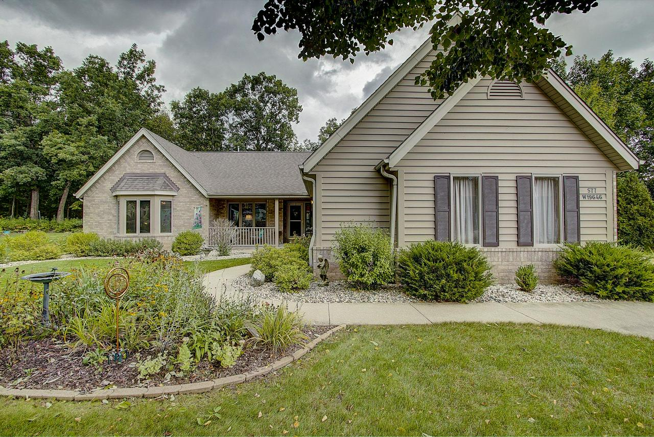Minutes from I 43, this beatiful brick ranch home offers one floor living on just under a 1/2 acre lot surrounded by mature trees and landscaping. Enjoy your morning coffee on your tranquil covered porch off the kitchen. Love having fires in the evening? The side yard with fire pit is the perfect place to relax after a long day. The open floor plan is terrific for entertaining, the living room with spectacular beamed vaulted ceilings opens to the eat in kitchen, the master suite features a large walk in closet and jetted tub. The finished lower level includes extra living space and plenty of storage. Thoughtful touches were included when this home was built. Located in the coveted Lake Forest neighborhood with a private park and access to Muskego County Park. This truly is a gem!