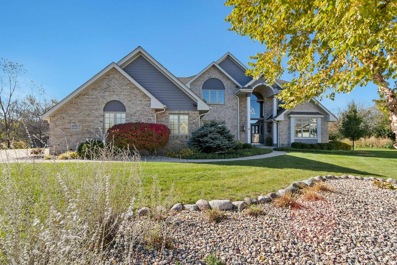 Custom home! Located on wonderful private lot. Foyer with open stair case to impressive master suite which includes private office, large WIC, GFP , bath with jetted tub & SS. Three additional upper bedrooms with large closets,Main level offers open kitchen with dinette l NEW Mohawk luxury vinyl flooring! Bar sink, cabinet lighting two ovens. Formal dining room  with BIC. Formal LR off of foyer features two sided GFP shared with family room. Large spacious family room with patio door Full bath and 2ND office also on main, Three car insulated garage H&C water. Triple pane Pella windows with BI blinds. Home & EXT wired with two stereo systems built in speakers. EXT LED landscape lighting is beautiful! Central vac, utility shed with skylite