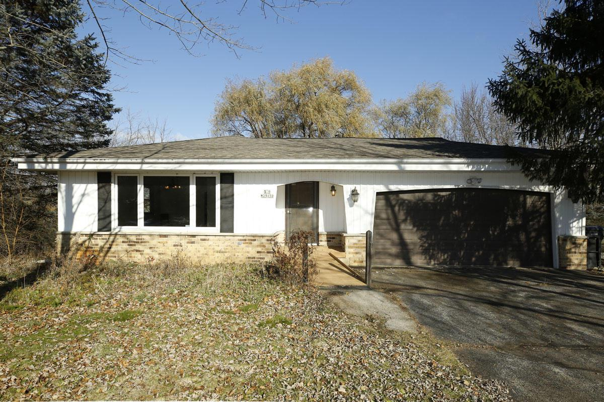 Ideally located move-in ready ranch! Just off the beaten path yet so close to all amenities-the best of country living with city convenience! Fresh paint and new carpet throughout the first floor. Big bright living room opens to the dining space. The eat-in kitchen has a large walk in pantry and overlooks the family room and natural fireplace. Great bedroom sizes and all with large double door closets! Updated bathroom, replacement roof and windows, new septic in 2018 and a convenient main floor laundry make this a great opportunity. The lower level awaits your family room or bedroom ideas. There is a full exposure and walk out egress so come build some equity in this great property! Low maintenance exterior leaves you time to enjoy the yard and cul-de-sac location.