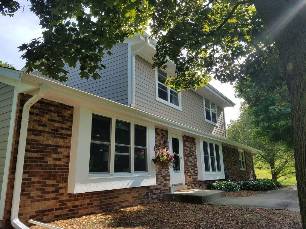 Only a relocation makes this home available. Completely remodeled colonial situated on almost 3/4 of an acre with outstanding views of the countryside and Holy Hill! Large stunning updated kitchen with slow close cabinetry, quartz counters and top of the line stainless appliances. Gas fireplace in ultra-cozy family room features view of incredible corner lot. Main level laundry. Half circle drive and tons of room to roam on this spacious property just steps from the 27-hole Ironwood Golf Course. Updates within past two years: new roof, siding, furnace, AC, water heater, all new windows, master bath, hardwood floors. Lake Country and award-winning Merton and Arrowhead School districts.