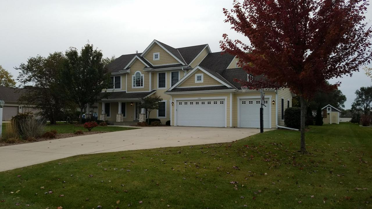Terrific New Berlin home only available due to relocation. This home features huge open kitchen with a lot of Birch cabinets, countertop space, Maple hardwood floors and walk in pantry. Great room displays gas fireplace with 9' ceiling and large Pella windows. Dinette surrounded with windows, additional space in dining room and a private den/ office. First floor laundry with Maytag W&D included. Open foyer leading to oversize master bedroom with tray ceiling and walk in closet. Master bath includes whirlpool tub, ceramic tile and double sink vanity. Lower level already finished with 1,000 SF of bonus space with a full bath. You can use the 15' Maple topped bar for gatherings. The rear yard includes a 24' pool with large deck and 10 x 12 garden shed. Don't forget to park in the 3 car garage