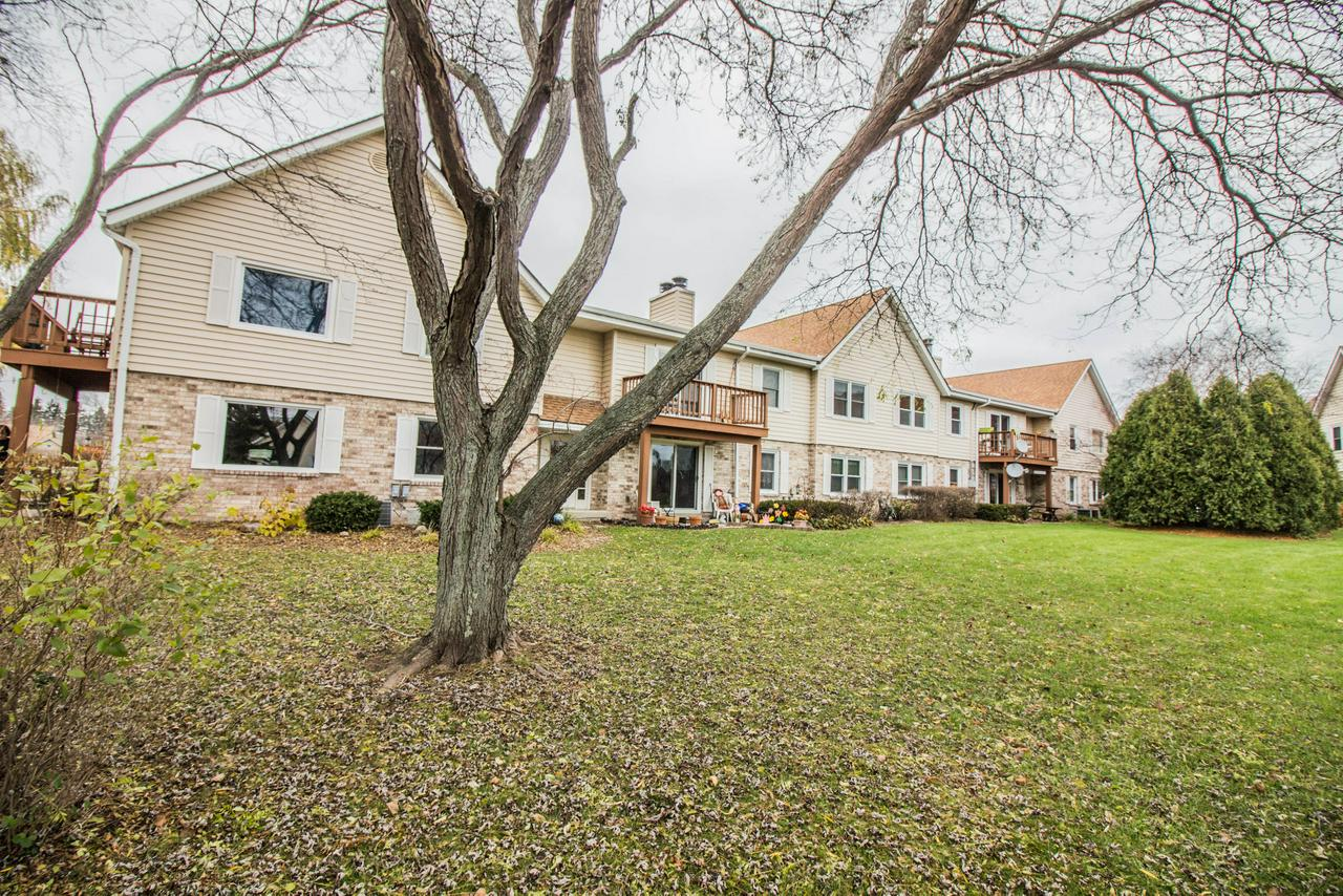 Why rent when you can own...in MEQUON!  This affordable & spacious 2 BD 2 BA 2nd floor condo is move-in ready.  Sellers just had the entire condo professionally cleaned & painted w/ neutral colors. Enjoy a kitchen with tall cabinets which offers a ton of space, granite counter tops & appealing accent lighting.  Other features include a massive walk-in closet in the master w/ ensuite, in-unit laundry facilities, a natural fireplace, a balcony surrounded by cedar trees for privacy plus a stunning view of the pond. No need to scrape your car in winter w/ 2 assigned parking spaces in the secure garage below.  Enjoy an in-ground pool, tennis courts & a clubhouse for booking gatherings. PETS ALLOWED. Property is close to shopping & restaurants. It's ideal for commuters w/ easy I-43 access.