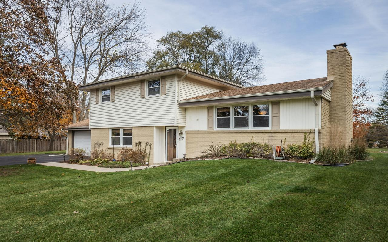 Open concept, sprawling tri-level in prime Mequon location! Spacious living completely updated with award-winning kitchen featuring granite countertops, large island & cherry wood floors open to dining room with impressive fireplace. Large family room with floor to ceiling windows and slider to private outdoor living space. Lower level boasts more entertaining space, ample storage and laundry. Hardwood floors found in all upper bedrooms. Spa-like master bath with double sinks, steam shower & luxurious finishes complete with dressing area. California closets throughout. Dedicated office can covert to 5th bedroom on main floor. Main floor full bath with tiled walk-in shower. Large impressive lot is .92 acres and features patio and fire pit. One Year HMS Home Warranty included.