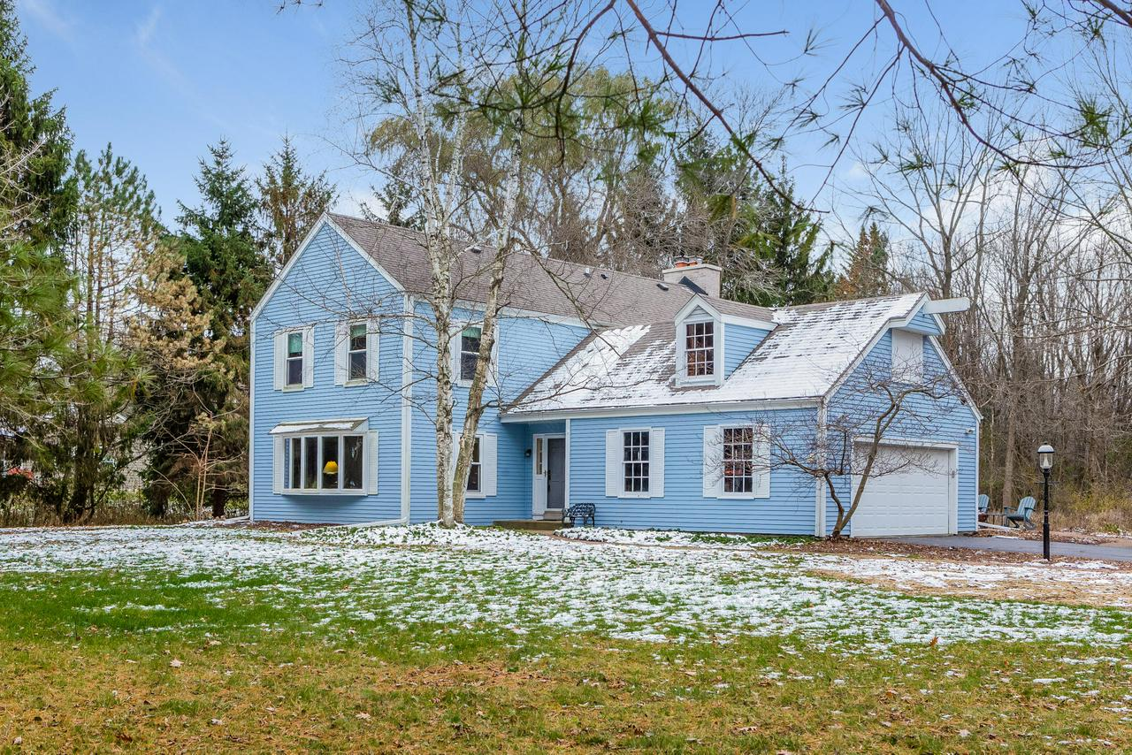 Only a relocation puts this lovely Colonial on the market! Situated in the SE corner of Mequon, you'll find sizable, sunny rooms offering generous living space and an effortless flow. Bright, open eat-in KIT connects to a cozy FR feat. NFP and sliding doors to backyard patio. Granite countertops and SS apps shine in this recently updated KIT with FF laundry conveniently just a few steps away! Large master suite is a must see, complete w/ NFP and master BA w/ whirlpool tub. Enjoy being just minutes to the freeway, parks and lakefront while savoring the low taxes of Mequon and the privacy of a beautifully wooded and spacious lot. Many big ticket items taken care of including roof, chimney and draintile. Seller has put a lot of heart and hard work into this home. Now it's your time to enjoy!