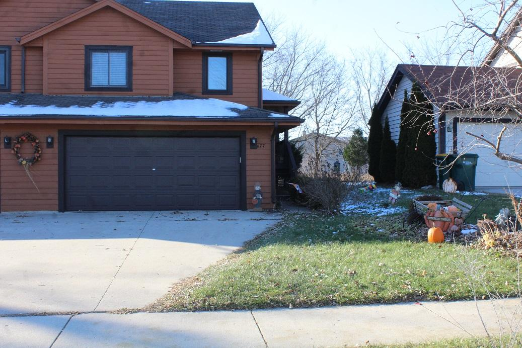 Well maintained and cared for condo and original owner.  This 3 bedroom split level condo has no condo fees or association.  Main level features living room, kitchen, and dining area with hardwood floors.  Dining area has patio door that leads out to upper deck with private backyard.  Two bedrooms on main level with full bath.  Lower level has large bedroom with another full bath and small room that could be used for office/storage.  Lower level also features laundry area and entrance to 2 car attached garage. Condo will have new roof installed by end of November and unit has had some new painting done.  2012 all new appliances, hot water heater 2015.  Come and make this your home.