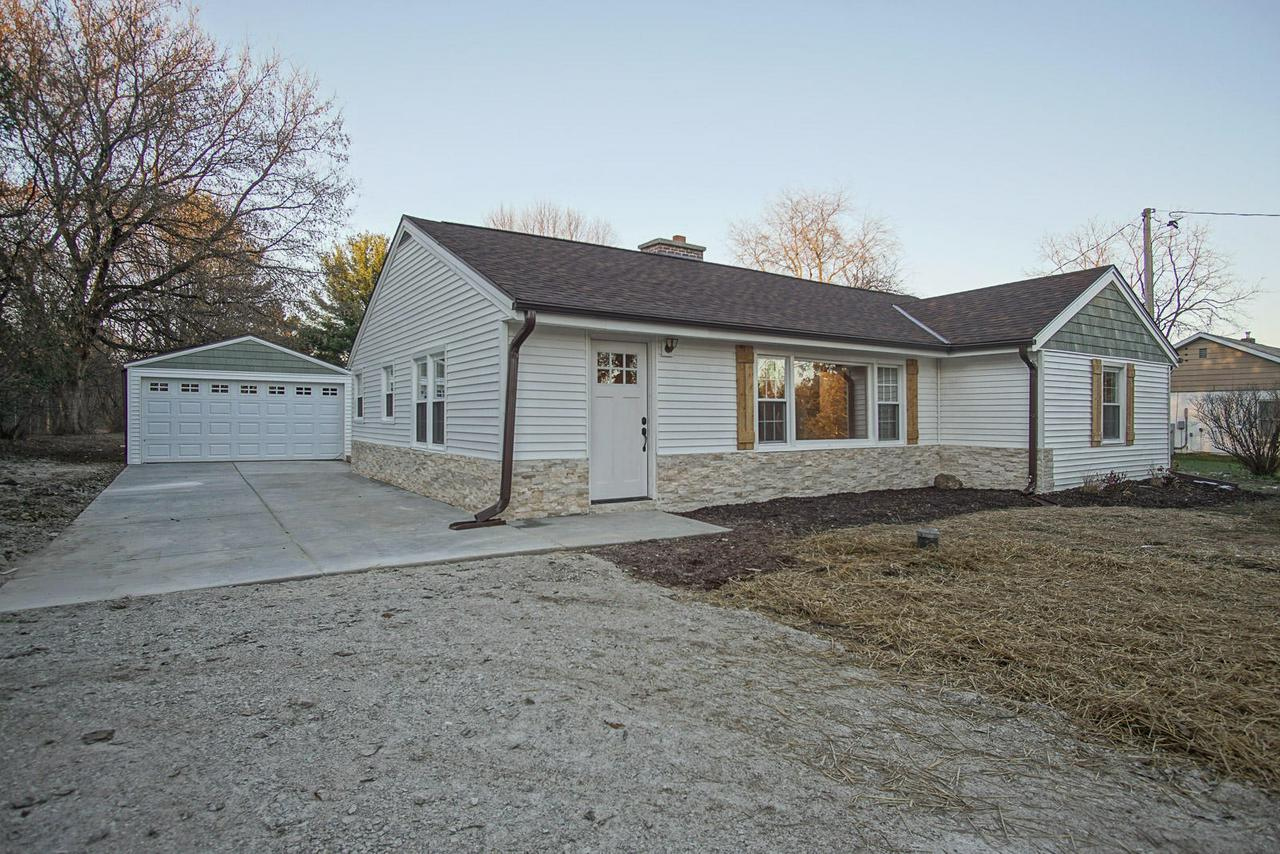 Rehab project done right- Must see!  This completely remodeled open concept ranch  is ready to go with new roof, siding, windows, deck, and other cosmetic updates. In the living room step onto the beautifully refinished chocolate brown floors and warm up in front of the natural wood burning fireplace. Retreat to your master suite for added relaxation. Almost an acre of yard for fun and privacy. Huge walk in pantry.  Brand new furnace, water heater, softener. Not one original water or drain line. Electrical updated as well. Dont let this one pass you by, schedule showing ASAP.