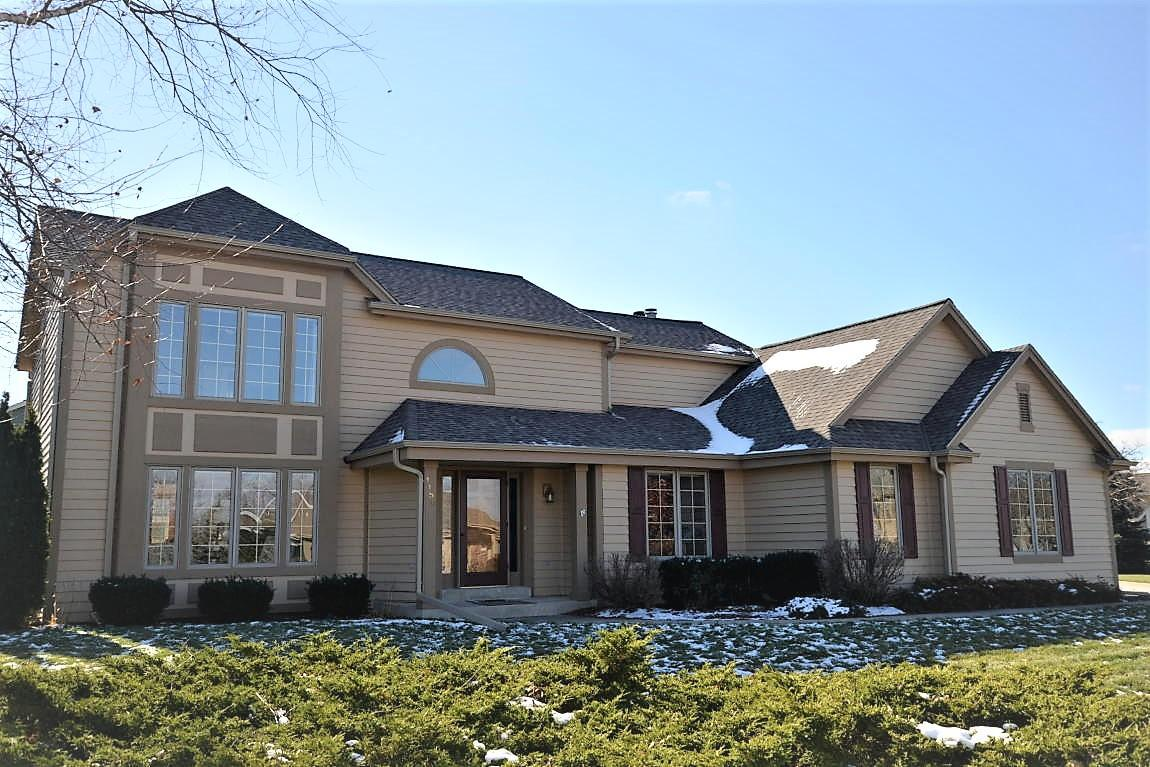 Executive, 2-story Colonial Home offers convenience, quality and one of the finest views in Pewaukee.  Close to shopping, Hiking, Swimming and more.5 Bedrooms, 3.5 baths, 2 whirlpool tubs, 2 NFP's, Central Vac, R/O in Kitchen, Patio plumbed for Hot Tub.  Home boasts New furnace, newer A/C, new roof W/50 year transferable warranty, skylights with Low E efficiency rating, new gutters and downspouts, new appliances and more.  Mother-in-law suite with 2nd full kitchen makes this a one of a kind home.  First floor laundry and 5th bedroom which can be utilized as an office. Did I say shopping, commuting to Milwaukee and recreation all within minutes from your door?  This home has so much to offer. Set up your showing today