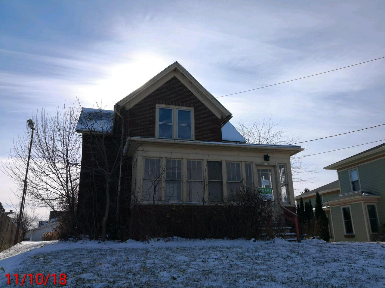 MUST SEE!!Great potential for this turn of the century Old Style 2 Story home. Over-sized L-shaped front porch is sunny and cozy. Original woodwork and maple floors really add to the charm.Sold AS-IS. Seller will NOT make any repairs. Data provided by third party has not been verified. No condition report will be provided. Property will not qualify for FHA. Cash offer or rehab loan needed.